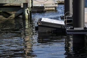 Marina Trash Skimmer attached to dock